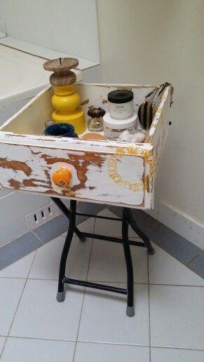 Old drawer conversion to bath accessories storage