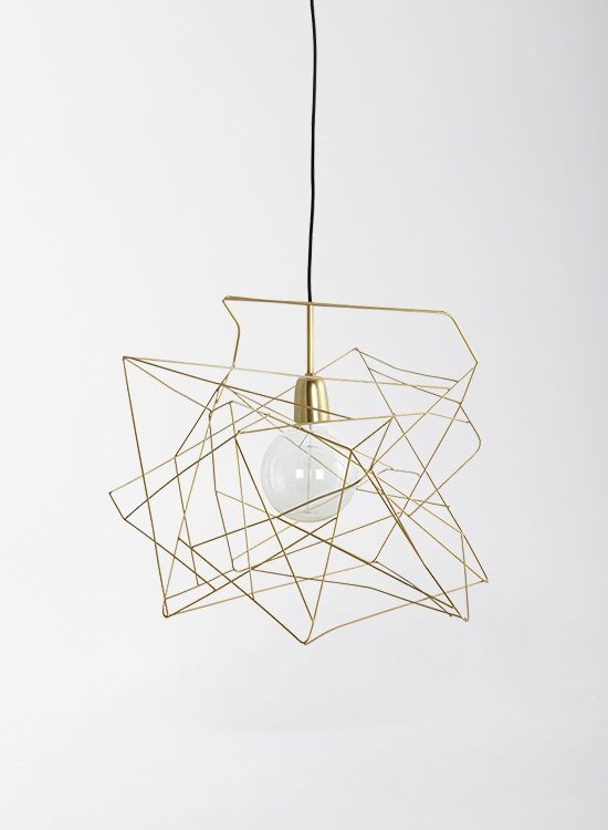 This is an impressive asymmetric brass wire shade. It will make a statement wherever you decide to hang it. This shade has a distinctive, unique design. It is sure to impress wherever you decide to hang it. It sits well with contemporary modern colour schemes and minimalist decor. These shades look even more striking when grouped in a set of two or three above a dining table or kitchen island. The pendant looks great when fitted with a retro globe Edison industrial style filament bulb…