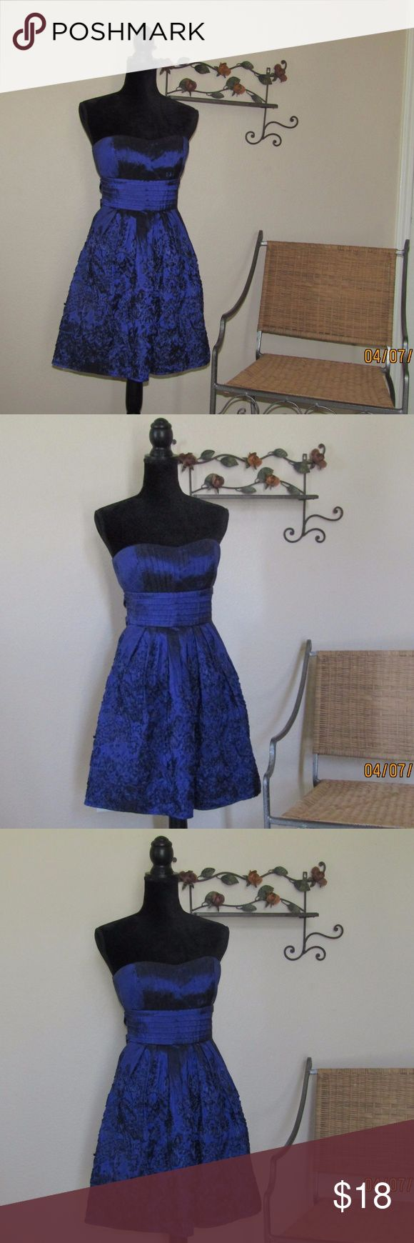 B. Smart Purple-Blue Formal Dress Strapless 7/8 NWOT B. Smart Formal Dress  Purple-Blue Silky Look Strapless with a ribbon flowery design  Large bow on back Size: 7/8 B. Smart Dresses Strapless
