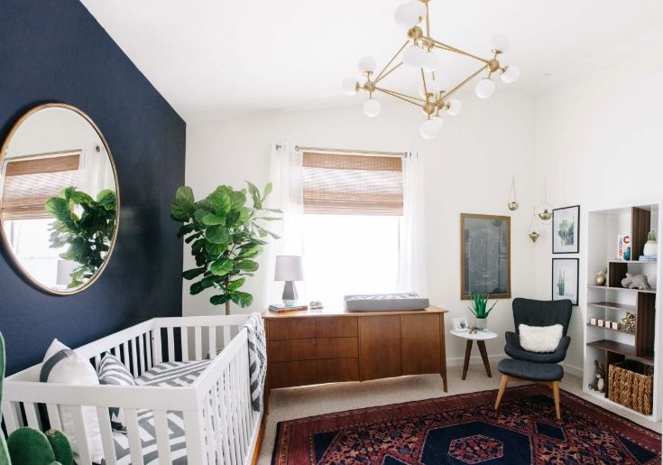 With the help of Oilo Studio, Julia's nursery makeover is a stunner. You might say the bold accent wall in Anchors Aweigh SW 9179 truly anchors the space, giving the rest of the room a light, bright freshness perfect for a growing family. Genius.