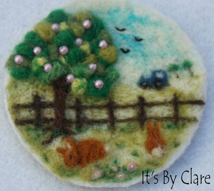 Unique dry needle felted brooch created by me using wool fibres, seed beads and embroidery floss. Measures 2 inches diameter