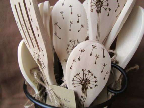 Make cooking fun with wood burned spoons inspired by nature. Sketched and burned by hand, each spoon is unique with decorative design on each