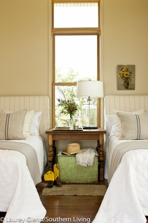 wood window frame // coordinated bedding // table over trunk: