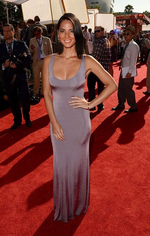 Olivia Munn attended the 2012 ESPY Awards in Los Angeles wearing this slim-fitting Armani jersey tank gown.    Letting the dress speak for itself, The Newsroom star took a minimalist approach to finishing her sensational look with flawless makeup, sleek locks and Bulgari jewels.