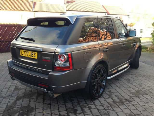 """2010 Range Rover Sport 3.0 TDV6 Autobiography estate in grey with black leather interior. 22"""" Overfinch alloys."""