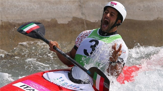 Daniele Molmenti of Italy celebrates winning the gold medal in the men's Kayak Single (K1) final on Day 5 of the London 2012 Olympic Games at Lee Valley White Water Centre.