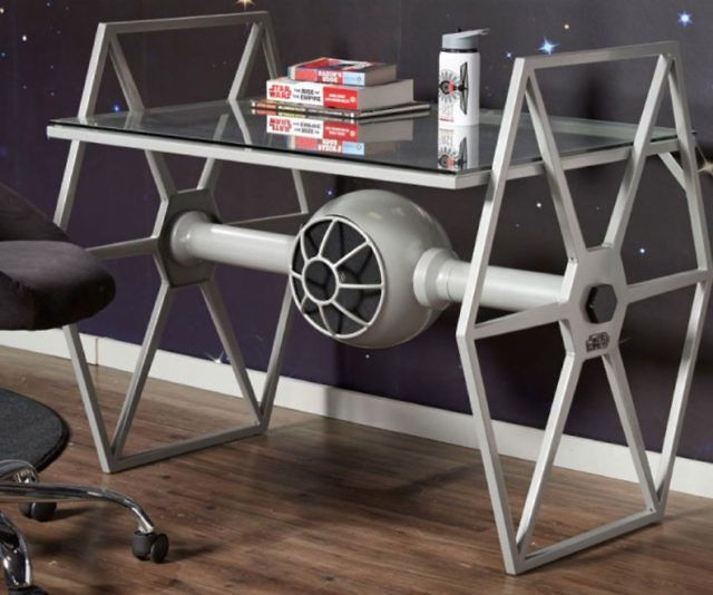 Give your geeky pad some Empire inspired flair with this Star Wars tie fighter desk. The tie-fighter shaped powder steel base sports a neutral grey finish and holds up a sunken tempered glass top ideal for work or displaying your Star Wars memorabilia.