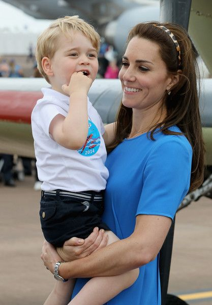 Kate Middleton Photos - Catherine, Duchess of Cambridge and Prince George during a visit to the Royal International Air Tattoo at RAF Fairford on July 8, 2016 in Fairford, England. - The Duke & Duchess of Cambridge Visit the Royal International Air Tattoo