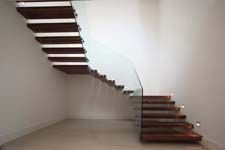 Company advertising for Regional Joinery, Cardiff, showing staircase in new luxury home.