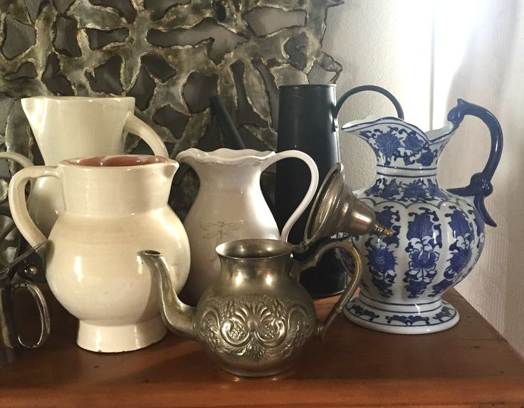 some of my collection of ceramic and metal jugs and teapots...