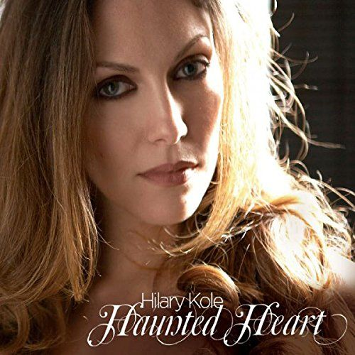 Haunted Heart:   After years performing in the world's top venues with such jazz legends as Hank Jones and Oscar Peterson, here is Hilary Kole's debut, produced by John Pizzarelli, a jazz star in his own right, and who also serves as the album's guitarist. Together, Hilary and John have assembled 13 songs with roots in the great American songbook, but largely unknown, including Tom Waits Old Boyfriends and You For Me, best known from the late Blossom Dearie's interpretation. Here is a ...