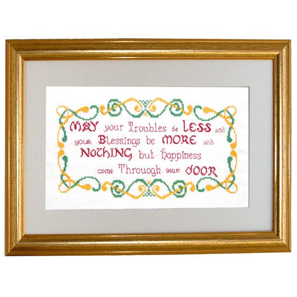 An exquisite hand embroidered traditional Irish blessing set in a handcrafted wooden frame.  Elegant script lettering in ruby red floss surrounded by Celtic scroll-work in vivid hues of emerald green and gold.  This beautiful creation would make a handsome addition to any wall in your home but would be especially eye-catching in your entrance hall.