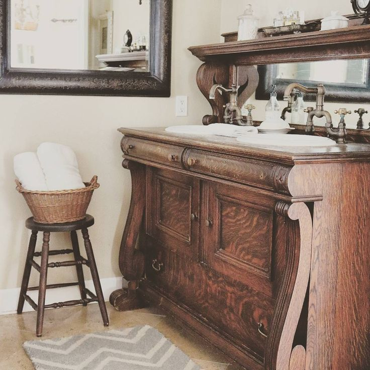 "Good morning! I've not ever shown you guys our vanity in our master bath. It's an antique buffet we repurposed to put our sinks in and ""hello storage!"" She's a beauty and holds all my stuff. She's my pick for #woodsandwhiteswednesday this week. Thanks for hosting Sheana @smalltowngirllife and Candice @agirlandherhouse. Do you want to play along Amy @farmhousedreamsabk and Sandy @vintage_bliss? I hope your day is beautiful! Blessings"
