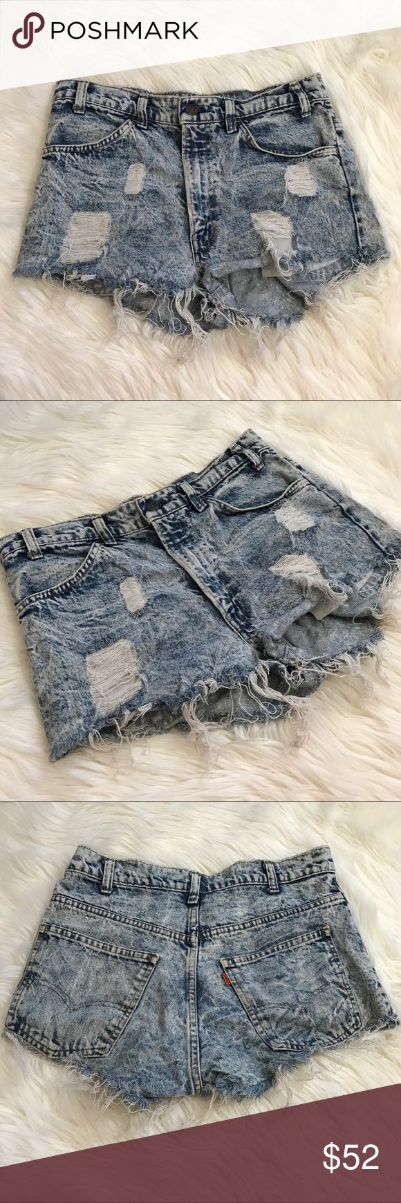 """Levi's Distressed Cutoff Jean Shorts Acid Wash Levi's pre distressed high rise/booty shorts cutoff jeans, Acid wash. There is no size tag present, but based off the measurements I believe these are a size 13/14. Measurements are approximately while lying flat: 16"""" waist & 32"""" in total around, 12"""" front length, 13"""" back length Please do not purchase these unless you know your measurements. All measurements are approximate. Selling as is. Marked at size 14 for exposure. Feel free to ask any…"""