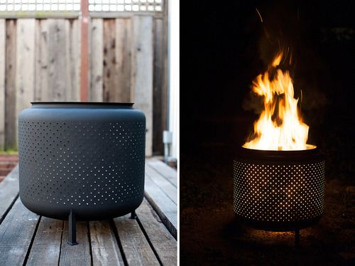 Washing-machine-drum becomes a firepit--- How cool is this??  Will be looking for a junk washing machine to make this for summer :)