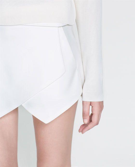 With a white blazer | MINI SKORT from Zara