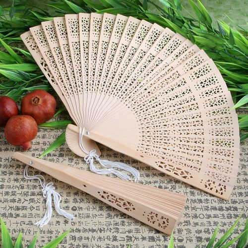Your guests are sure to be big fans of these sandalwood fan favors Treasured for thousands of years, sandalwood is a uniquely fragrant wood known for its distinct color and its ability to support intricate carvings.