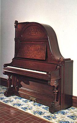 Upright grand (giraffe) piano by Schimmel & Nelson, Faribault, Minnesota, ca. 1889.