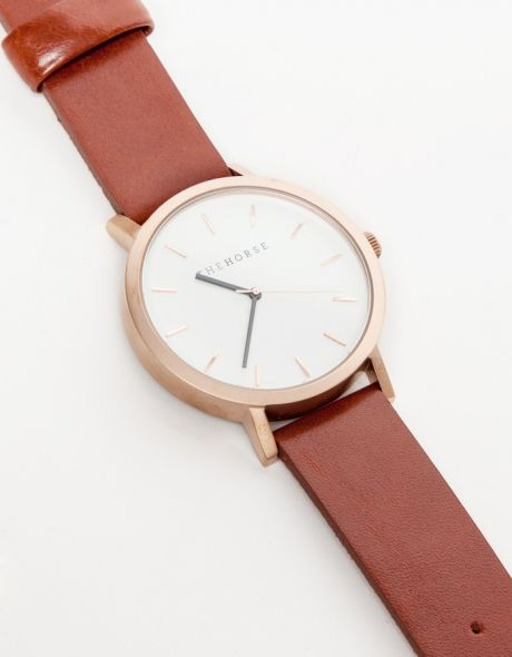 A simple and clean wrist watch from The Horse with a sandblasted IP rose gold coated stainless steel face, white face and premium walnut leather band.   •Genune Italian leather details and lining •Japanese Quartz movement •Stainless Steel Bezel,