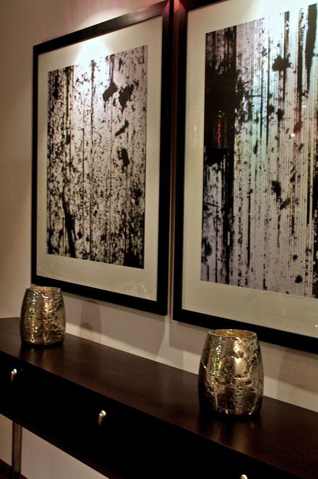 Artwork adds a personal touch to minimalist spaces.