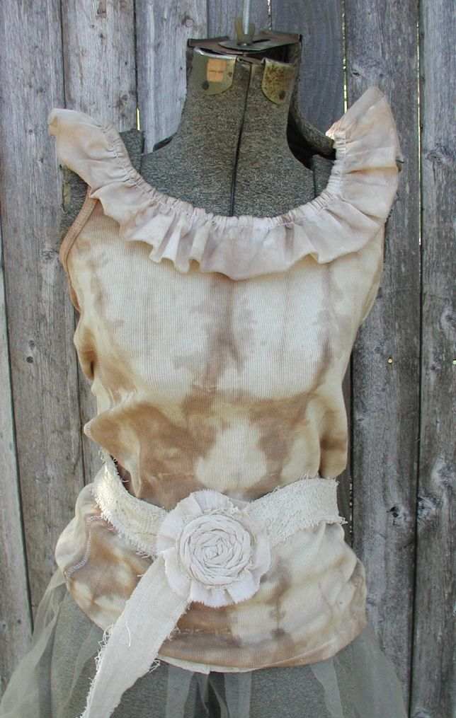 """Creamy caramel and tan tie dyed tank top with a 2 """" (approximate) ruffle sewn around the neckline. Goes great with jeans or a casual skirt. Sizes Medium through XX Large are available. Each shirt may be somewhat different than the photo due to the tie dye process."""