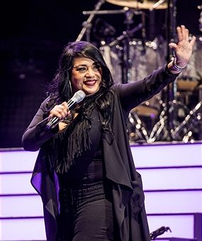 Suzette Quintanilla waves to the crowd at the MAC Selena World Premiere Concert on September 30, 2016 in Corpus Christi, Texas.