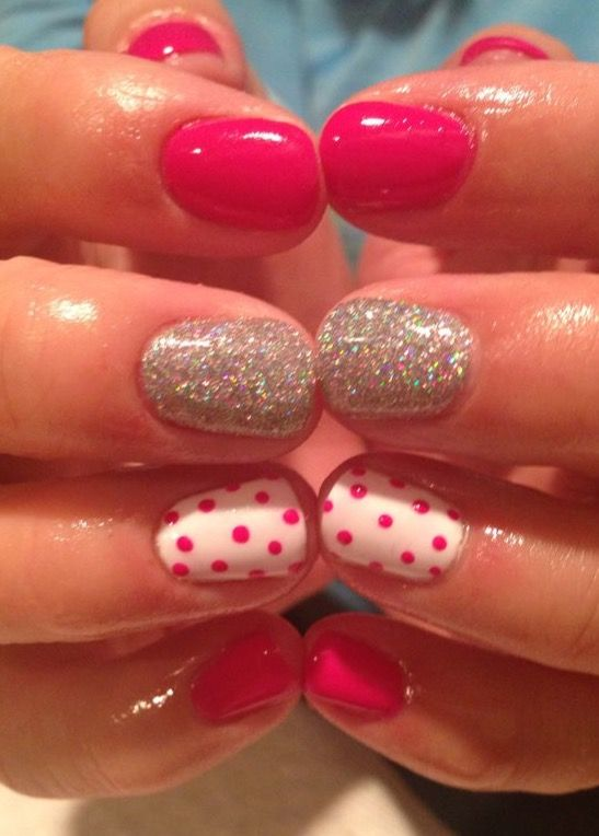 Pink nails for summer with polka dots accent
