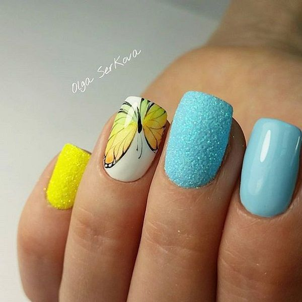 Summer themed butterfly nail art. The bright colors of the polish make it very pleasing to the eyes and their combination highly complements each other. The yellow butterfly detail also looks perfect against the white background.