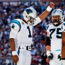 Carolina's Cam Newton, who spoke last week about the need for unity in America, raised a clenched first as a sign of solidarity after becoming the first quarterback in NFL history to rush for 50 touchdowns.