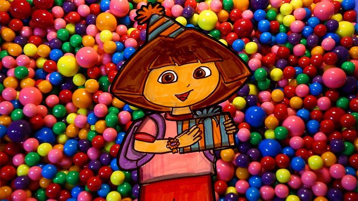 Drawing of Dora the Explorer wearing a birthday hat and holding a present is then coloured by markers.