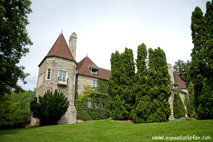 """Eaton Hall is a château in King City, Ontario, Canada built in the Norman style for Lady Flora McCrea Eaton in 1937 on a 700 acre (2.8 km²) parcel of land, which had been acquired by Lady Eaton and her husband, Sir John Craig Eaton. Lady Eaton moved into Eaton Hall following the demolition of her city mansion, Ardwold. The house is adjacent to a body of water named Lake Jonda (a combination of the first three letters of her son John David Eaton's first and middle names)"