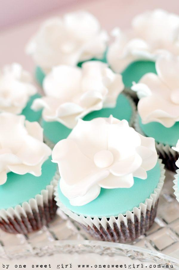 Maybe with a brown cupcake, and teal or green icing and a cream flower? Or cream icing and a teal flower.
