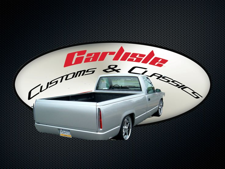 1989 Chevy Silverado Custom Truck with silver paint, custom roll pan, and custom integrated Cadillac DeVille lights.