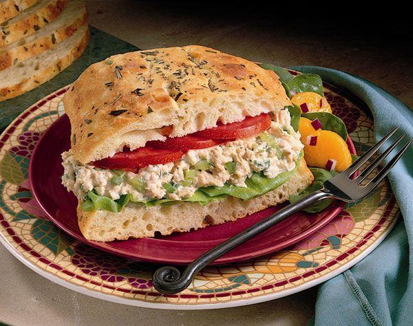 Salmon Salad Sandwich - 1 can pink salmon, green onion, celery, dill, lemon juice, seasoned salt, mayo, lettuce, tomato, rustic bread (eg. focaccia)  GP: Use GF bread, low fat mayo, omit celery and green onion