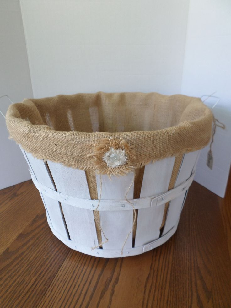 Bushel basket lined with burlap...boy, that was a learning experience!