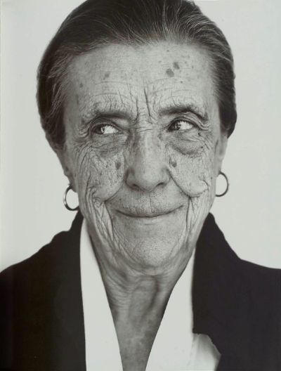 Louise Bourgeois and her perennial small gold creoles.
