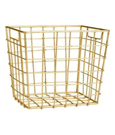 Gold-colored. Metal wire basket with handles at sides. Size 5 x 5 1/2 x 6 1/4…