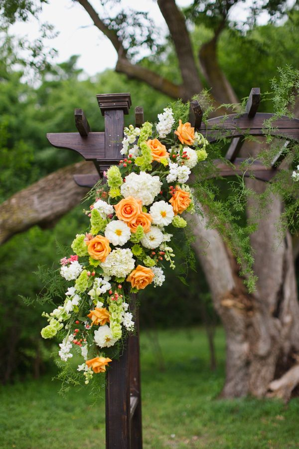 wedding ceremony arch filled with yellow, white and green florals. See more of this rustic wedding here http://www.weddingchicks.com/2013/09/05/hope-glen-farm/