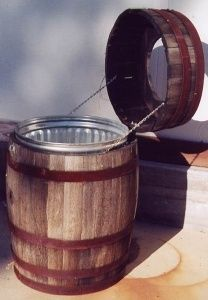 Trash can for the back patio..LOVE this idea. My grandpa made barrels for Seagrams, so this reminds me of him.