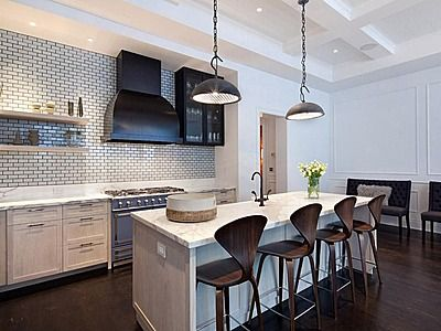 Stools with backs would be helpful for the kids. Then it can become the spot for homework. - Cherner Kitchen Stools in classic walnut