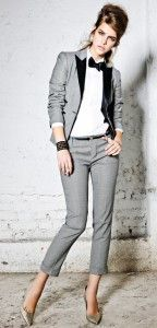 Black bow tie, white shirt, grey pant suit, pumps. Learn more about how to wear a bow tie >>> http://justbestylish.com/9-tips-how-to-wear-a-bow-tie-for-women/