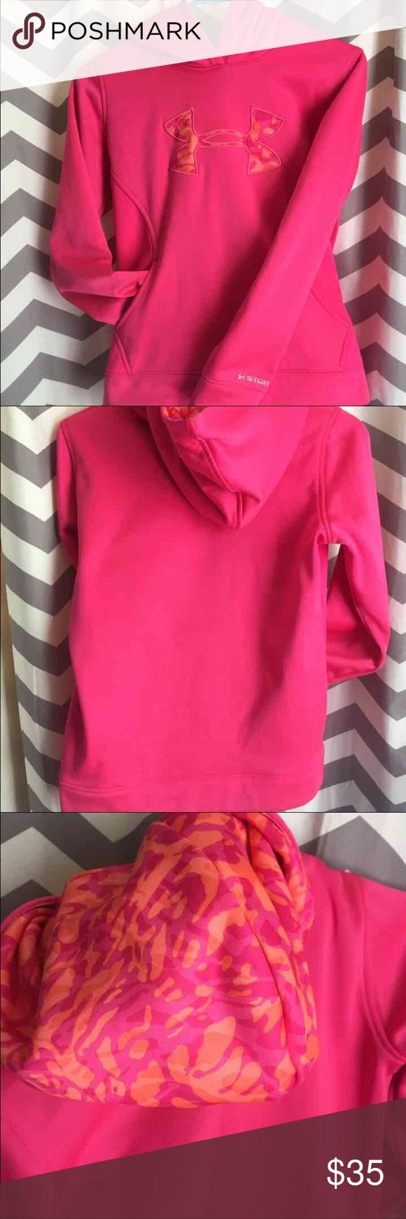 Youth girls Under Armour sweatshirt -no stains, no rips, smoke free home -like new, lots of life left in it, it no longer fits me -very warm inside -pink and orange camouflage print Under Armour Shirts & Tops Sweatshirts & Hoodies