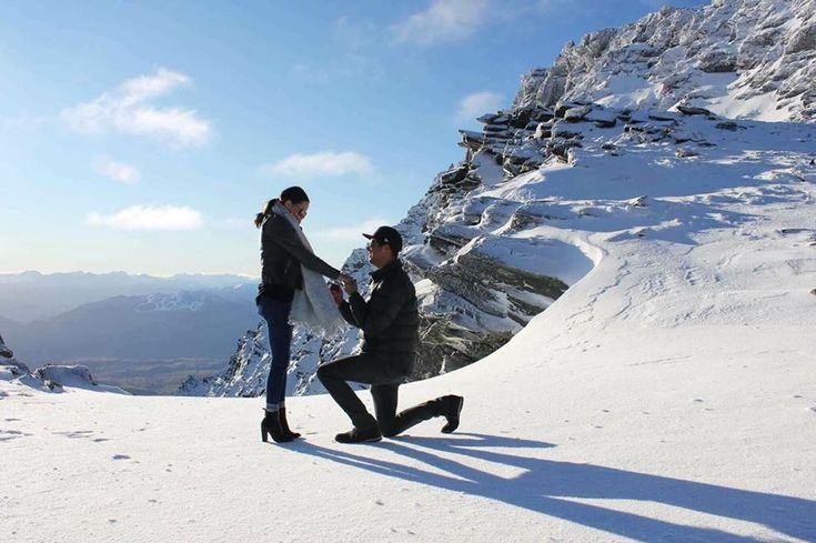 A Queenstown, New Zealand proposal featuring a beautiful couple and The Diamond Shop cushion cut engagement ring.