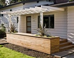 Front Porch ideas... How about a raised flower bed instead of a railing...?