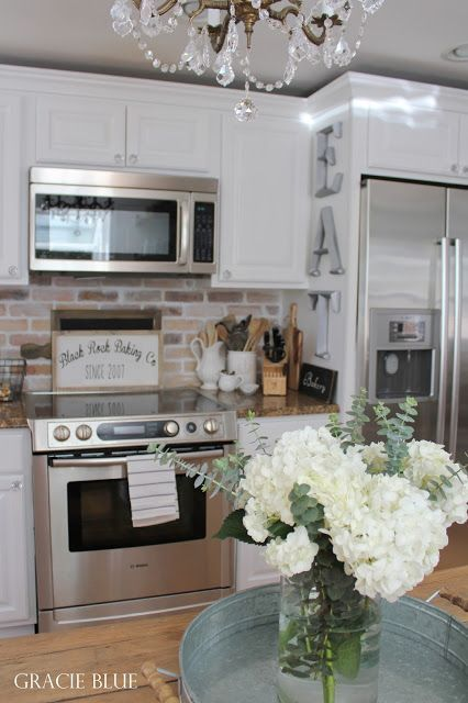 White Kitchen Makeover with Stainless Steel Appliances, adding farmhouse charm by Gracie Blue
