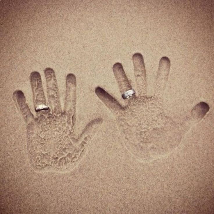What a great wedding photo idea – rings in the sand.