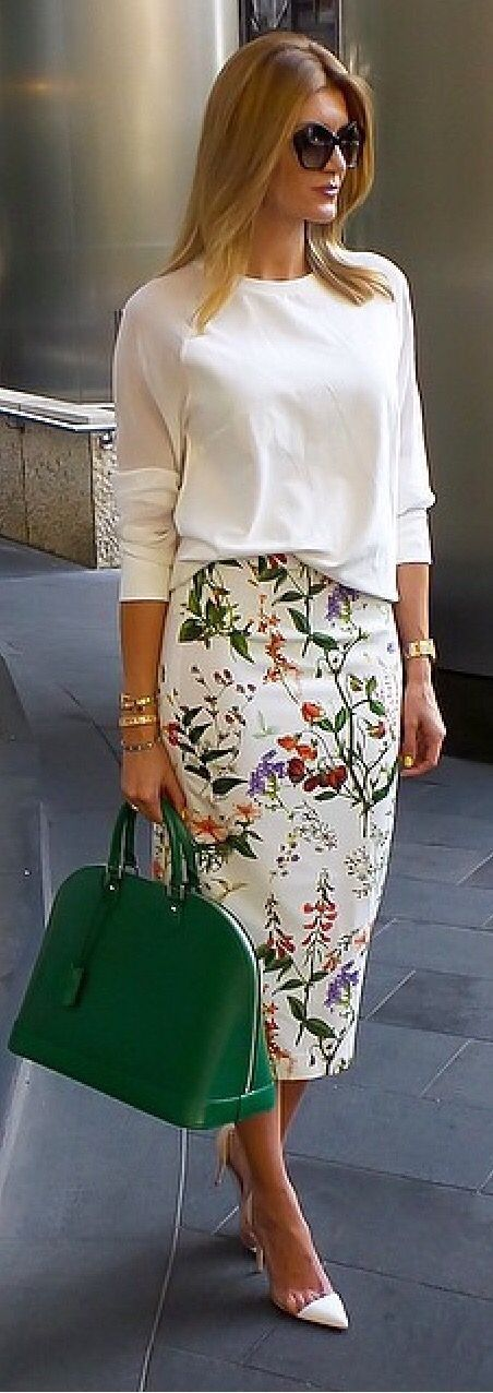 Cute white blouse, floral midi skirt and a green bag