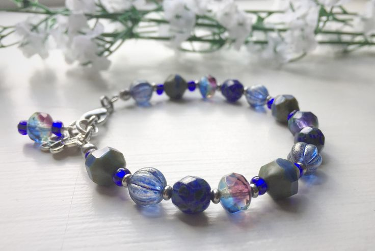 Beaded bracelet in shades of blue and steel