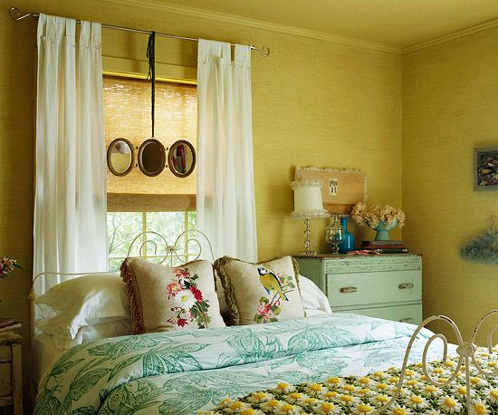 A fresh green and white comforter is offset with a vintage daisy afghan, while birds on the pillows introduce the home's running theme: http://www.bhg.com/decorating/decorating-style/flea-market/decorate-with-vintage-finds/?socsrc=bhgpin030314layers&page=13