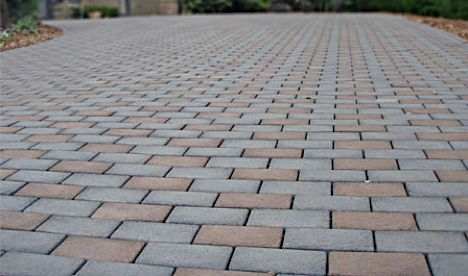 I want this! Recycled tire bricks on driveway! Green, more porous and pretty cheap!